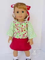 Make a holiday blouse for your 18 inch doll with the easy and fast School Bell Blouse sewing pattern from Oh Sew Kat! Visit my blog to try a free skirt sewing pattern. #ohsewkat #18inchdollclothes #sewingpattern #easytosew