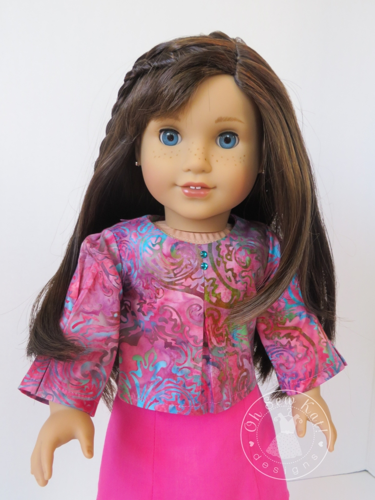 Make a long sleeved blouse for your 18 inch doll with the School Bell Blouse PDF sewing pattern from Oh Sew kat!