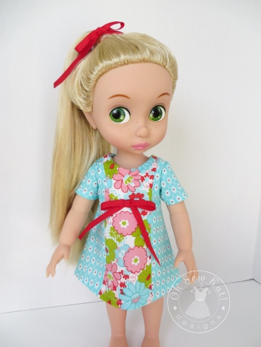 Make a simple summer dress for your 18 inch doll with the Sunshine Dress PDF Pattern from OhSewKat! Also available for 16 inch dolls like Animators. #dollclothes #sewingpattern #summerclothes #dolloutfit #sunshinedress #ohsewkat #animators