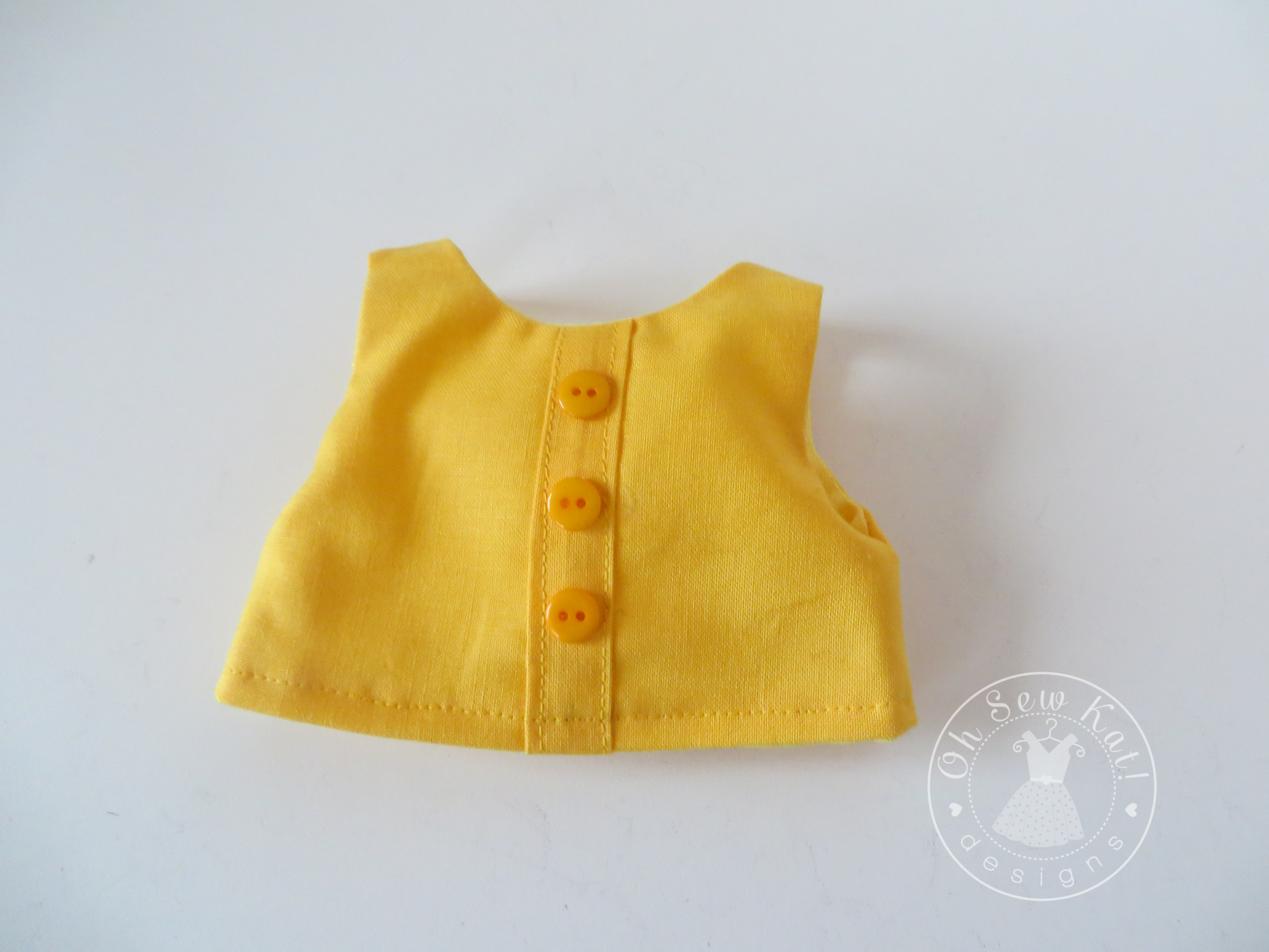 Doll Clothes Top and Dress Tutorials to step up a doll bodice with stitching or a placket. Easy sewing patterns for 18 inch doll clothes, plus free skirt sewing pattern, at www.ohsewkat.com. #dollclothes #sewingpattern #ohsewkat #18inchdolls #americangirldoll #welliewishers