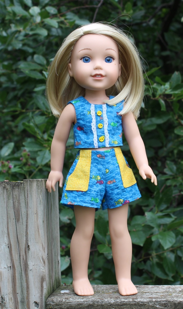 Make a summer outfit for your wellie wishers doll with easy sewing patterns from Oh Sew Kat! PDF sewing pattern for wellie wishers dolls sandbox shorts popsicle top.
