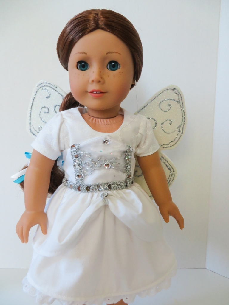 Make an angel costume or simple dress for your 18 inch doll using easy sewing patterns from OhSewKat. Print at home PDF patterns for beginners. #ohsewkat #angel #saige #18inchdoll #sewingpattern #dollclothes #halloweencostume