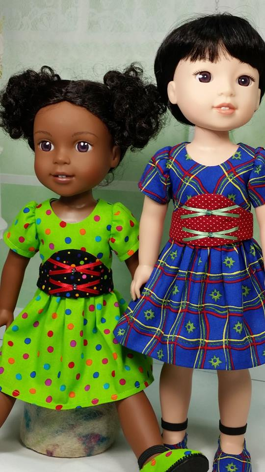 Make pretty dresses for your Wellie Wishers dolls with easy to sew beginner level patterns from Oh Sew Kat!