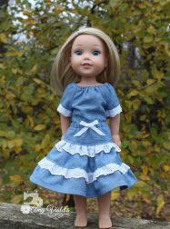 Add lace to a ruffled doll skirt with this free skirt pattern and tutorial for 18 inch and 14 inch dolls like American Girl. Get a Free skirt pattern at www.ohsewkat.com. Playtime Peasant Top and Twirl Skirt PDF print at home digital pattern for 18 inch dolls like American Girl. #ohsewkat #sewingpattern #dollclothes #laceskirt #ruffle