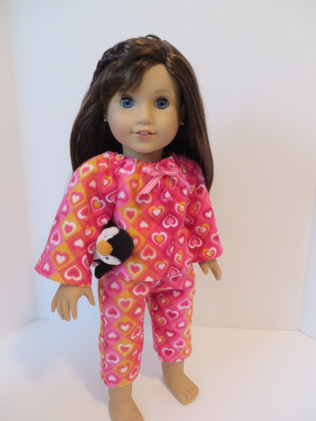 Make a Valentine outfit for your doll with easy sewing patterns by Oh Sew Kat! Simple to sew PDF digital patterns for dolls like American Girl, Disney Animators, Bittty Baby and A Girl For All Time. #dollclothes #valentinedress #sewingpattern #ohsewkat