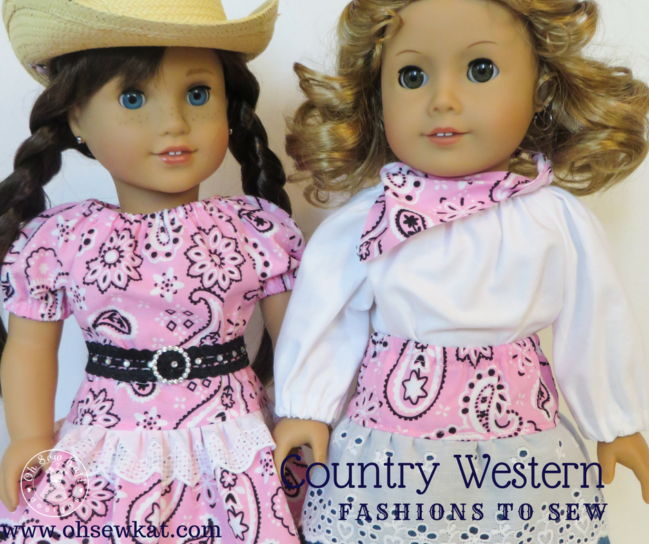 Two dolls wearing clothes made of pink bandana fabric with denim and lace accents