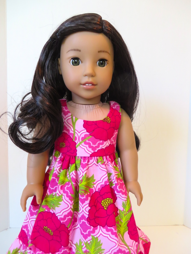 Make a muumuu dress for Nanea. Learn to sew doll clothes with easy sewing patterns by oh sew kat! American Girl doll clothes patterns plus free skirt pattern at www.ohsewkat.com. #dollclothes #diy#sewingproject #beginner #ohsewkat