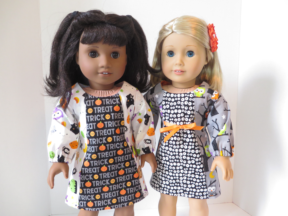 Halloween fashions and Fall dresses to sew for 18 inch dolls like American Girl with easy sewing patterns from Oh Sew Kat! Make cute pumpkin or spooky bat doll dresses with this print at home easy PDF pattern. #halloween #pumpkins #dollclothes #fallfashions #ohsewkat