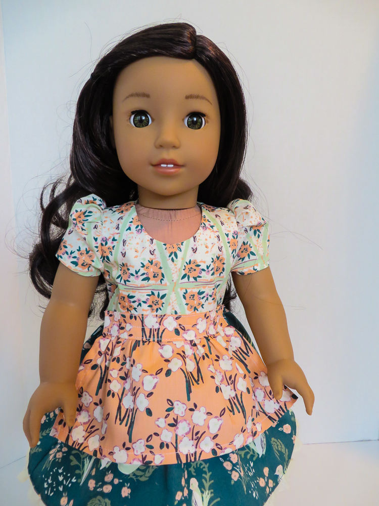Make your 18 inch doll a gorgeous dress like this Sugar n Spice Dress made with Bonnie Christine OLLIE fabric.  Find easy PDF printable sewing patterns for 18 inch dolls and other sizes in the Oh Sew Kat Etsy Shop.