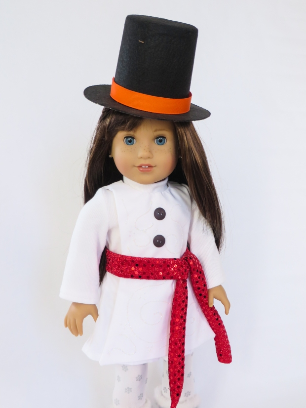 Make a snowman outfit for your American Girl doll with the Jumping Jack easy sewing pattern by Oh Sew Kat. #ohsewkat #easypattern #dolltutorial #jumpingjack #snowmancostume #halloween