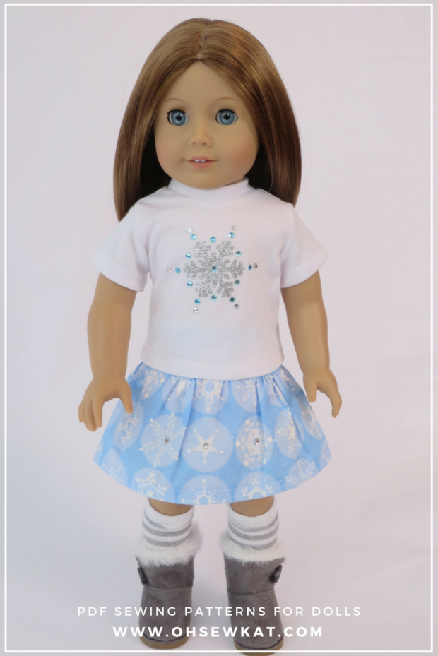 Make a sparkly snowflake tee shirt for your 18 inch doll with this quick and easy HTV tutorial by Oh Sew Kat!  Find more sewing patterns for American Girl dolls (free skirt pattern) at www.ohsewkat.com.  #ohsewkat #cricuttutorial #dollteeshirt #htvtutorial #dollcraft #sewingpattern
