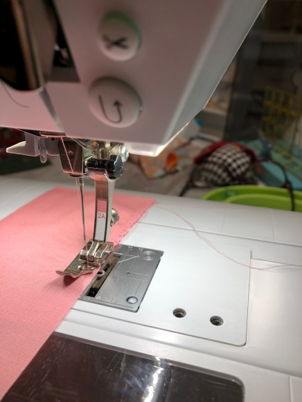 Bernina overlock foot 2a on coral fabric