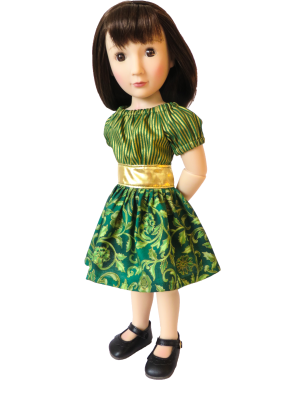 A girl for all time doll in green Christmas party time dress