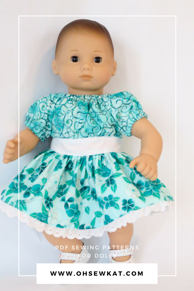 Bitty Baby doll in teal flowered dress with lace edge