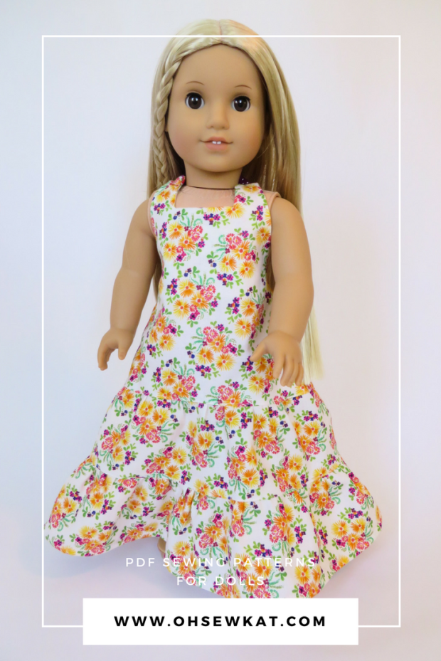 Make a halter back sundress maxi dress for American Girl doll Julie with this easy sewing pattern by OhSewKat. #maxidress #dolldress #sewingpattern #ohsewkat
