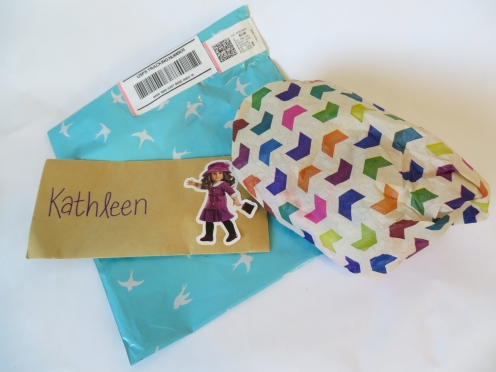 mailing envelope with letter and tissue wrap