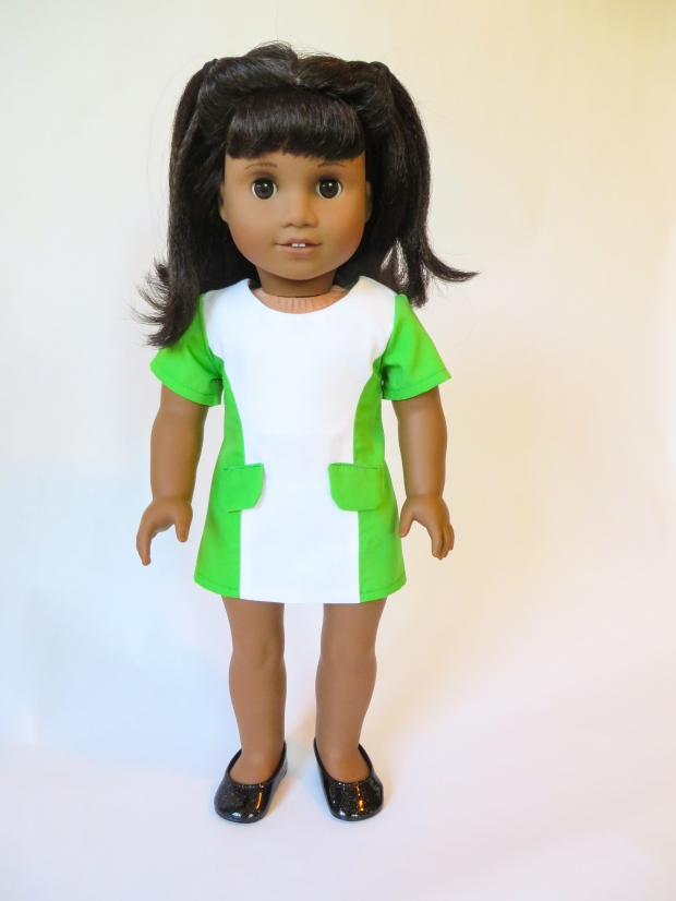 Melody doll in green dress with fake pockets
