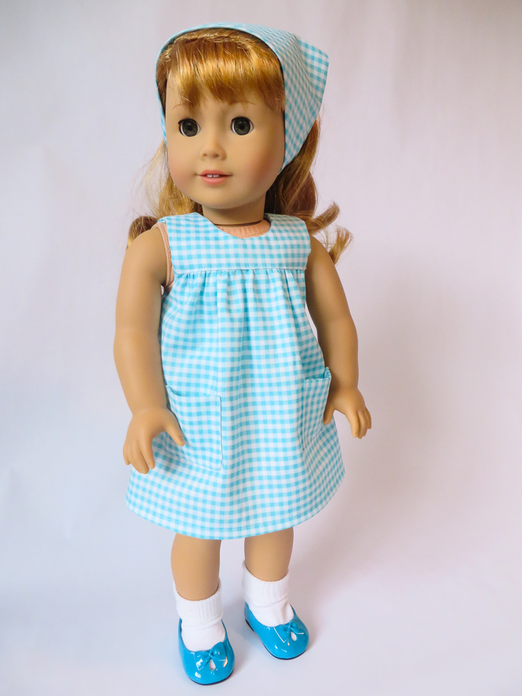 Make a 50s style gingham smock dress for BeForever character Maryellen or other 18 inch dolls with this easy Pattern Hack. Add pockets to the Bloomer Buddies easy sewing pattern by Oh Sew Kat! with this simple tutorial. #sewingpattern #18inchdoll #50sfashions #dollclothes #patternhack #ohsewkat