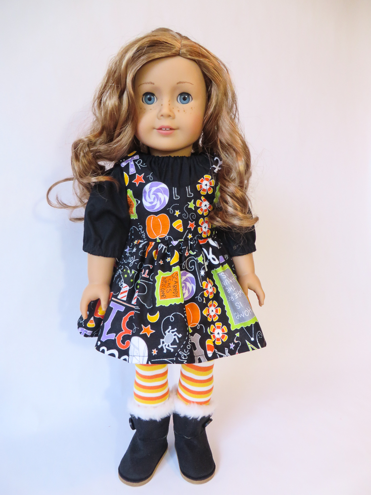 Find easy sewing patterns to make 18 inch doll clothes for your American Girl Doll from Oh Sew Kat! Try a free skirt pattern at www.ohsewkat.com. #sugarnspice #dolldress #halloween #ohsewkat #americangirl