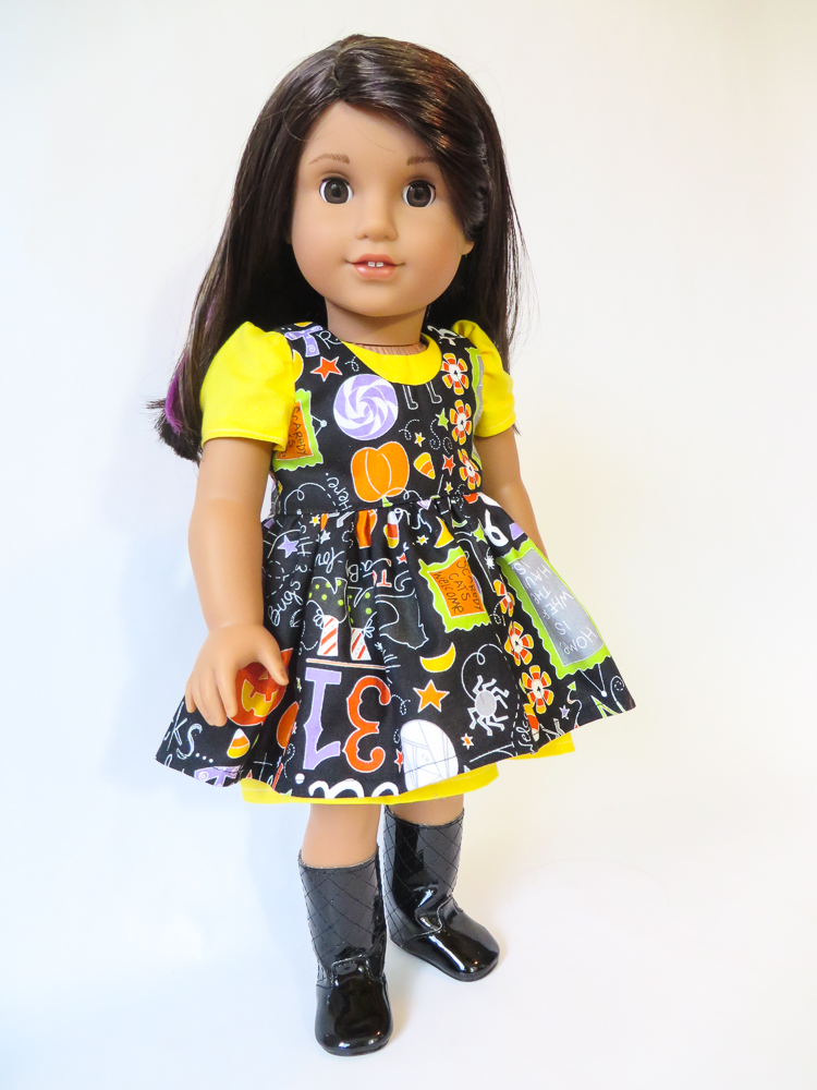 Simple sewing patterns for 18 inch dolls like American Girl by Oh Sew Kat! Sugar n Spice Dress and pinafore pattern to DIY doll clothes for your Luciana doll or her friends. #sewingpattern #dolldress #americangirl #ohsewkat