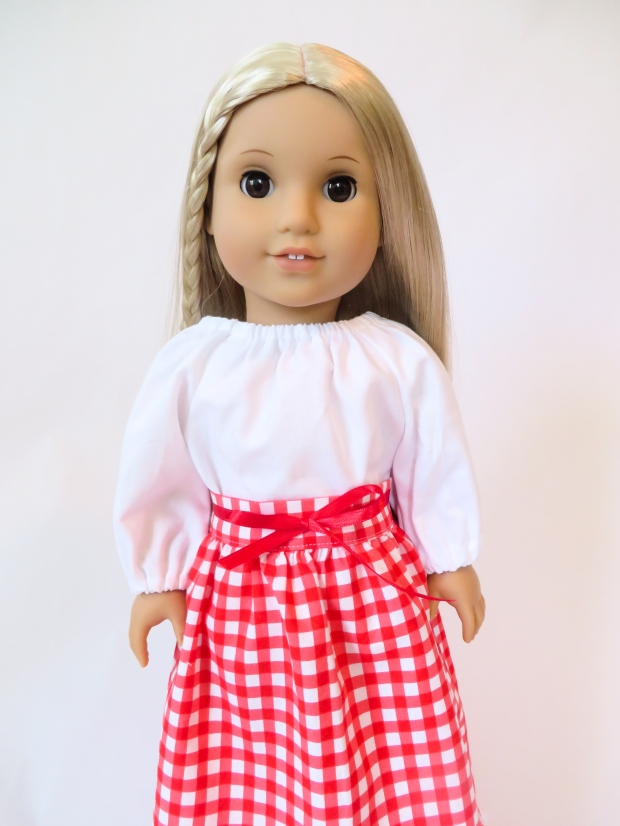 Julie doll in white top and red gingham long skirt