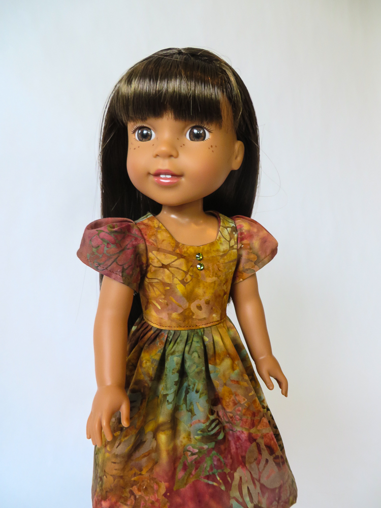 Try easy to sew patterns to make doll clothes for American Girl Dolls and Wellie Wishers. PDF sewing patterns by Oh Sew Kat! Sugar n Spice Dress in Fall Batik fabric. #ohsewkat #easysewing #dollclothes #dollpattern