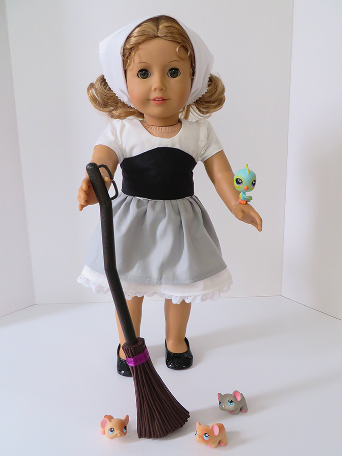 Make a Cinderella inspired outfit for your 18 inch doll with easy PDF sewing patterns from OhSewKat. #ohsewkat #dolldress #cinderella #americangirldoll #sewingpattern #easytutorial