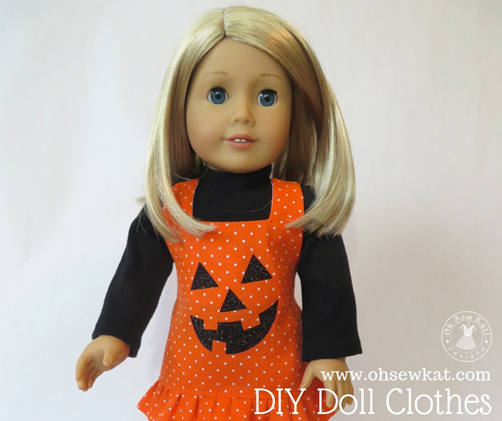 "Make a cute pumpkin jumper for your 18"" American Girl doll with the easy, Boardwalk Boutique PDF sewing pattern by Oh Sew Kat!. Download a free trial pattern at www.ohsewkat.com. #ohsewkat #18inchdoll #americangirldoll #sewingpattern #pumpkin"
