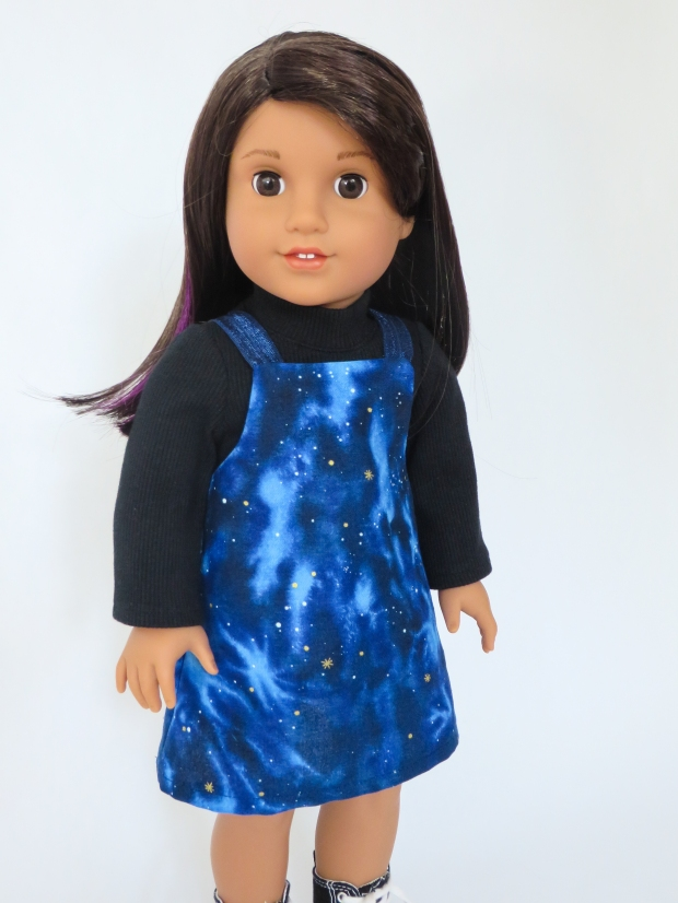 Easy jumper sewing pattern from oh sew kat for 18 inch dolls like American Girl. Luciana Vega loves her reach for the stars galaxy dress this fall. #ohsewkat #luciana #americangirl #galaxy #dolldress #sewingpattern