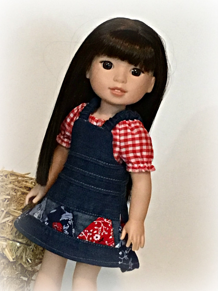 Make a reversible jumper for your 14 inch Wellie Wishers Glitter Girls doll with this easy PDF sewing pattern by OH Sew Kat! Easy to sew beginner level pattern. #ohsewkat #welliewisher #sewingpattern #falljumper #dollclothes #autumncrafts
