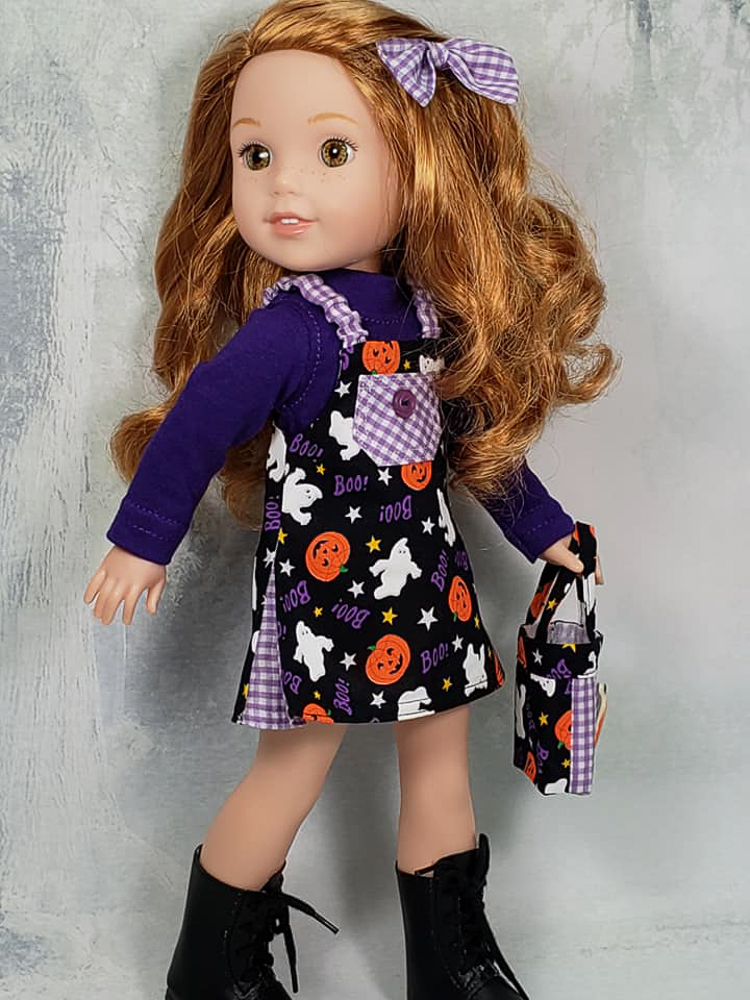 Make a reversible jumper for your 14 inch Wellie Wishers Glitter Girls doll with this easy PDF sewing pattern by OH Sew Kat! Easy to sew beginner level pattern. #ohsewkat #welliewisher #sewingpattern #falljumper #dollclothes #halloweenoutfit