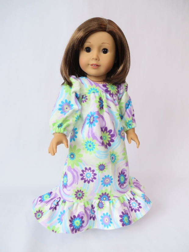 Make a snuggly nightgown for your 18 inch doll with easy sewing patterns by OhSewKat. #sewingpattern #dollclothes #nightgown #ohsewkat