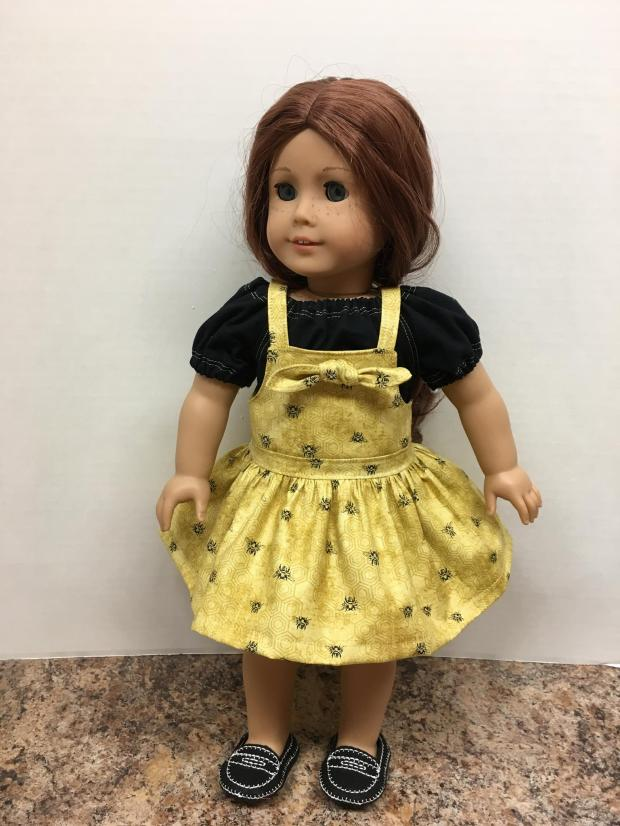 Make these easy bibbe overalls for your 18 inch doll like american girl with the Backyard Bibs PDF sewing pattern from OH Sew kat. #blairewilson #18inchdolls #sewingpattern #dollclothes #ohsewkat