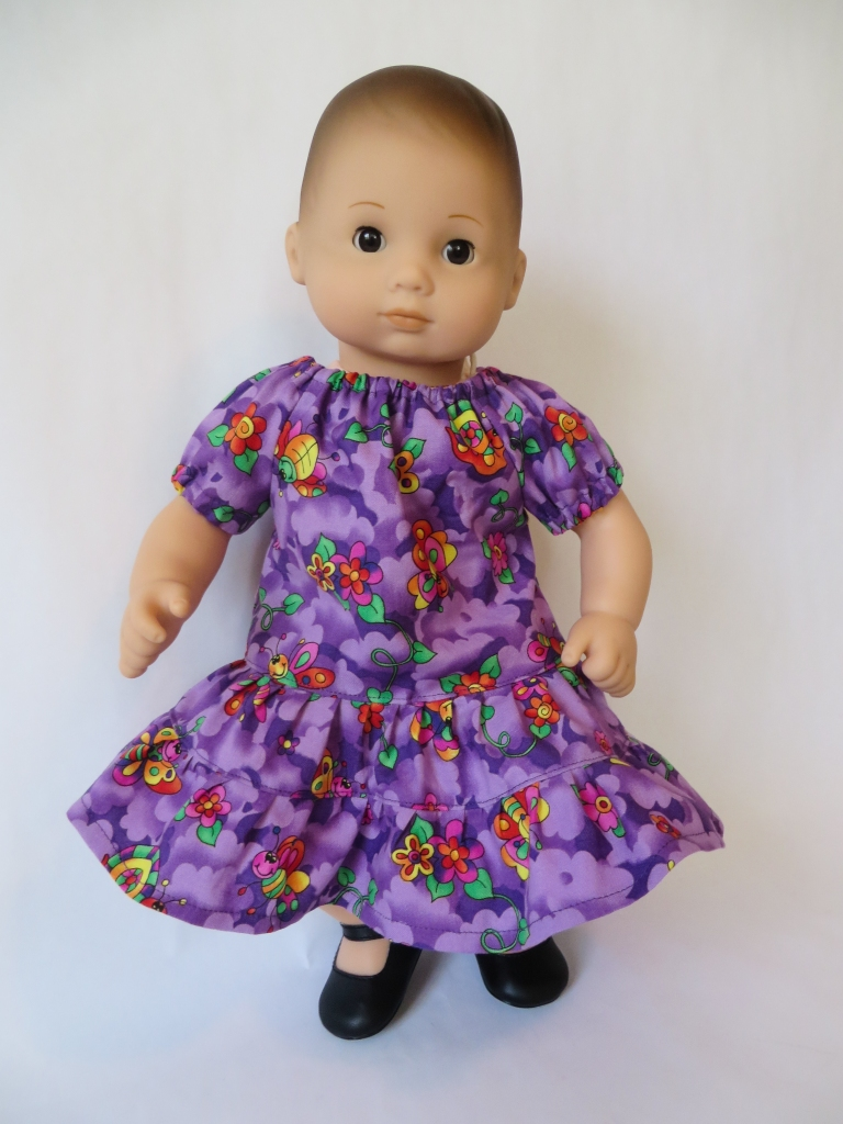 Make a dress for your Bitty Baby American Girl doll with this easy PDF sewing pattern for dolls by oh sew kat! #sewingpattern #dollclothes #beginnerproject #diydollclothes #ohsewkat
