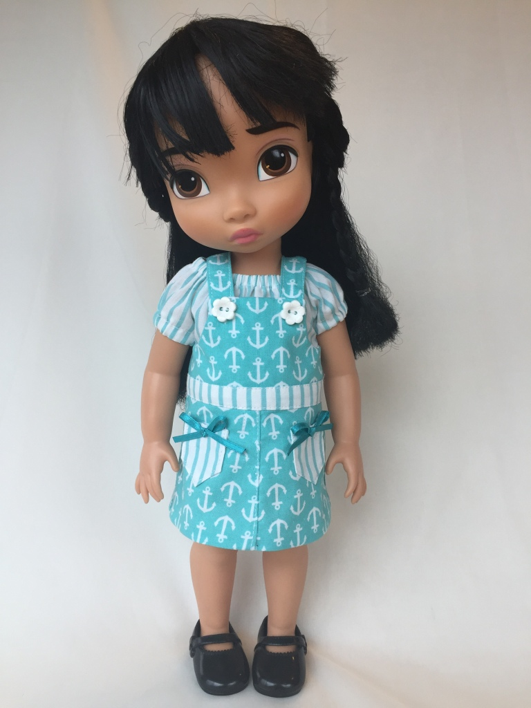 Make adorable Backyard Bibs outfits for your 16 inch Animators dolls with this easy sewing pattern from OhSewKat. Also available sized for 18 and 14 inch dolls on Etsy. #animators #dollclothes