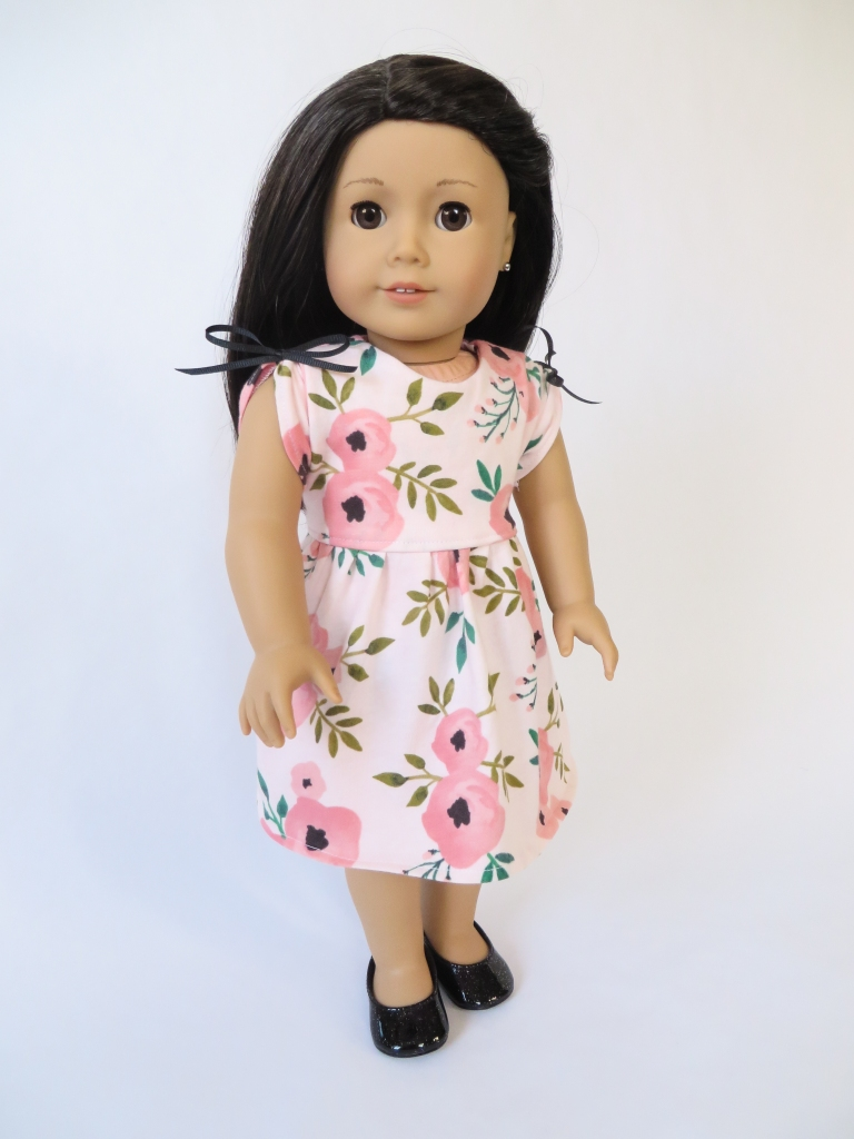 Make a cute, sleeveless top for your 18 inch doll with this easy pattern hack of the School Bell Blouse sewing pattern by Oh Sew Kat! #americangirl #18inchdolls #ohsewkat #dollclothes #patternhack