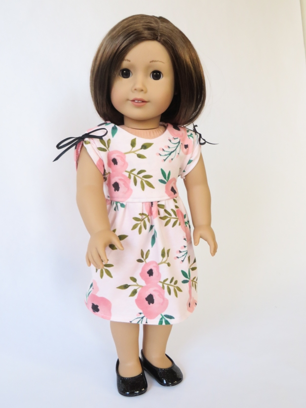 Make a knit dress for your 18 inch doll with this easy pattern hack of the April Moon sewing pattern by Oh Sew Kat! #americangirl #americangirldolls #ohsewkat #dollclothes #patternhack