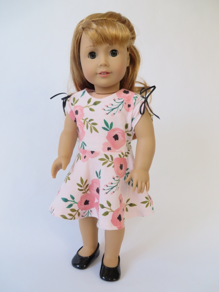 Make a knit dress with circle skirt for your 18 inch doll with this easy pattern hack of the April Moon pajamas sewing pattern by Oh Sew Kat! #americangirl #18inchdolls #ohsewkat #dollclothes #patternhack