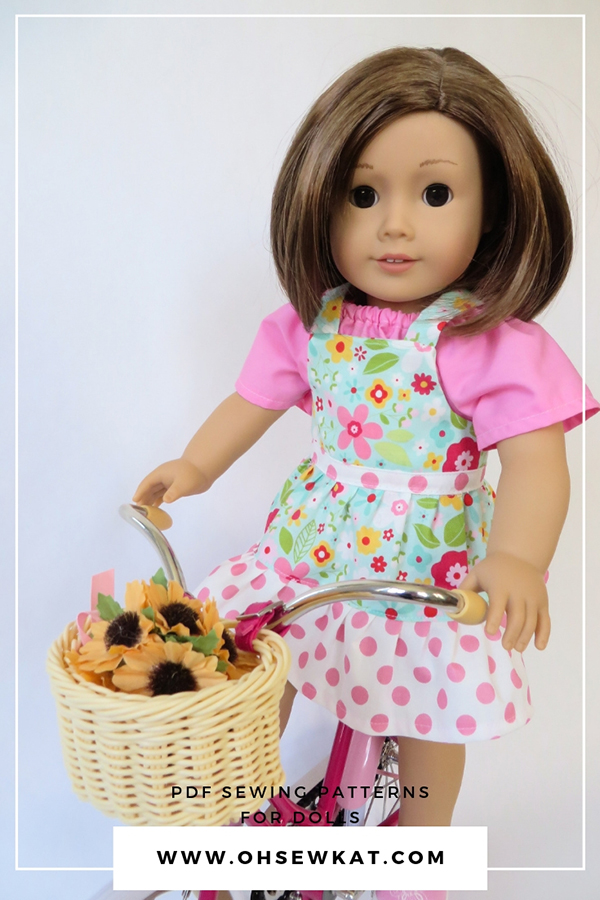 Add a ruffled skirt to the easy Backyard Bibs PDF sewing pattern to make overalls for your 18 inch dolls by OH Sew Kat.