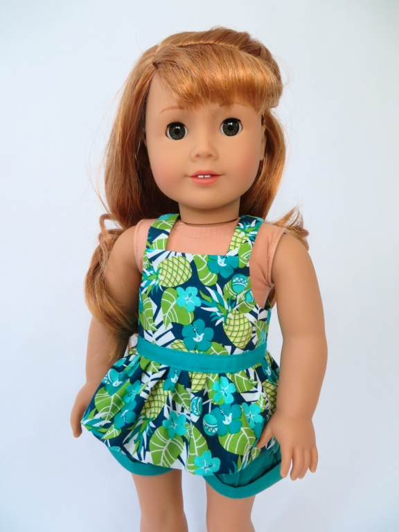 Use the Backyard Bibs PDF sewing pattern to make as summer doll top for your 18 inch American Girl doll. Easy sewing patterns for all seasons by Oh Sew kat!