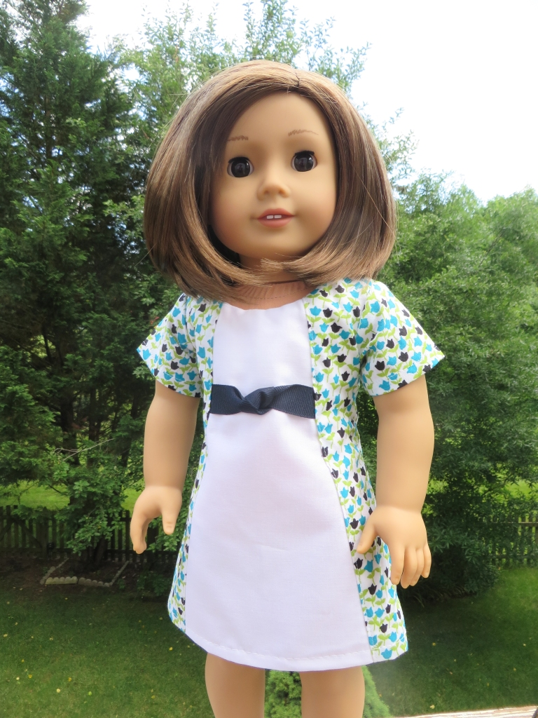 Sew an easy dress for 18 inch dolls with a simple sewing pattern you print at home. Oh Sew Kat! patterns are full sized pieces with photo tutorials to sew doll clothes.