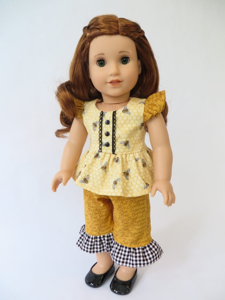 Make a doll dress for your 18 inch doll with the flutter sleeve Spring Shine Dress sewing pattern from oh sew kat! It's easy to DIY your own doll clothes and be a fashion designer~