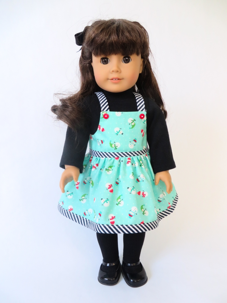 Stripes and snowmen! Make a Backyard Bibs and Jumping Jack turtleneck outfit for your 18 inch dolls like American Girl with easy sewing patterns from OhSewKat!