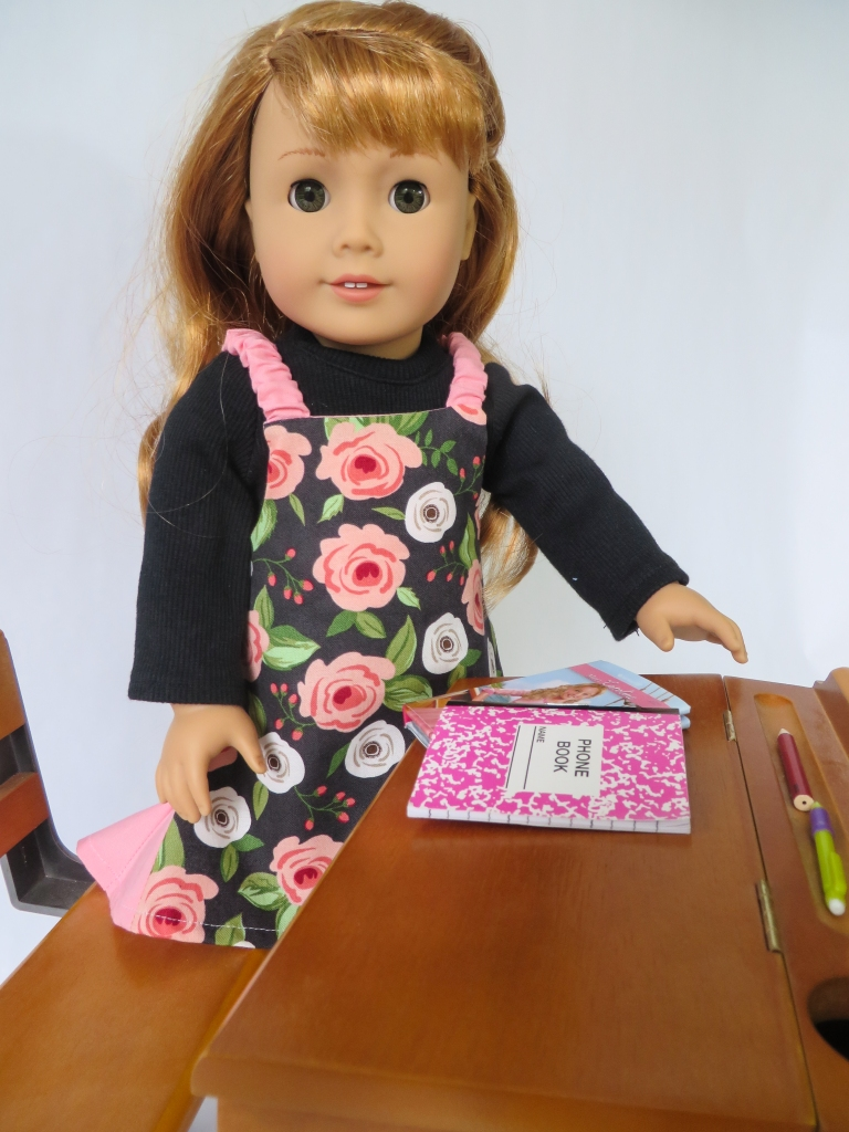 Maryellen Larkin is ready for school in a rose covered Easy Up! Jumper. Sew doll clothes for your 18 inch dolls with easy sewing patterns from Oh Sew Kat!