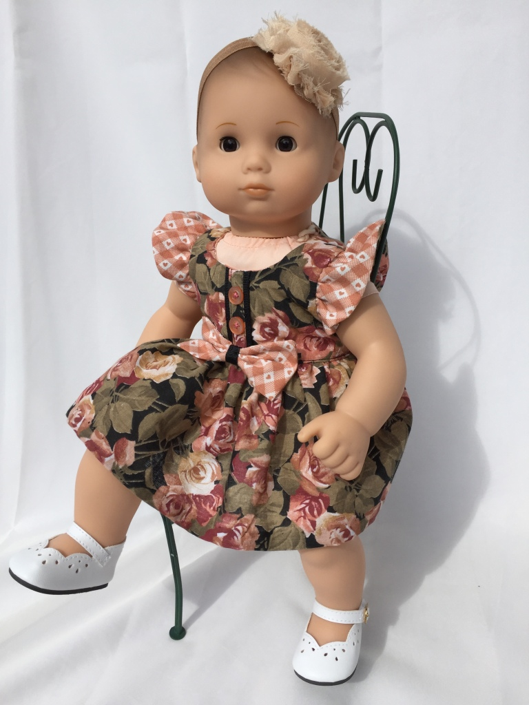 Make a pretty sundress for your 15 inch baby dolls like Bitty Baby and Bitty Twins with this Spring Shine Dress sewing PDF sewing pattern by Oh Sew Kat! Faux placket and flutter sleeves, make it a dress or a simple top. Easy to sew pattern for beginners. #ohsewkat #bittybaby #sewingpattern