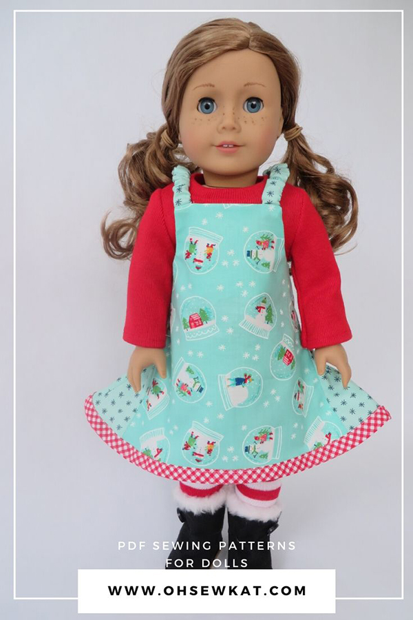 Make a holiday jumper for your 18 inch American Girl doll with a very easy jumper pattern by ohsewkat.  Find the full selection in my Etsy shop!  Made with fabric from Merry Merry Snow Days by Moda Fabrics.