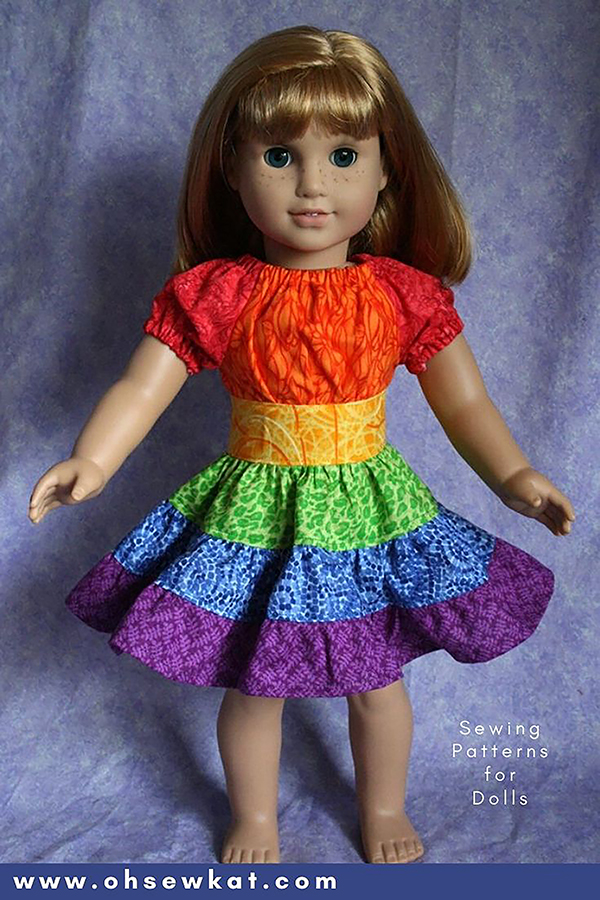 Make a rainbow dress for your 18 inch doll using the easy to sew Party Time Peasant Dress PDF sewing pattern from OhSewKat. Find more simple patterns for dolls at OhSewKat on Etsy.