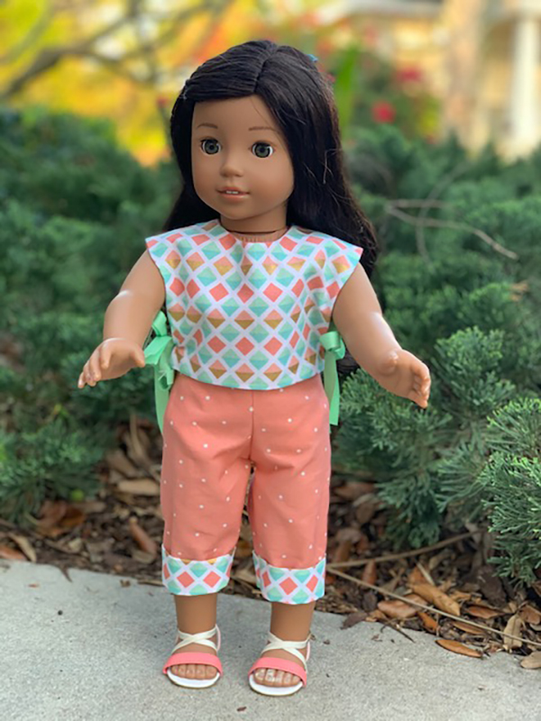Download and sew the quick and easy Picnic Play PDF sewing pattern and make a summer outfit for your American Girl Doll. Find more doll clothes sewing patterns in the OhSewKat Etsy shop.