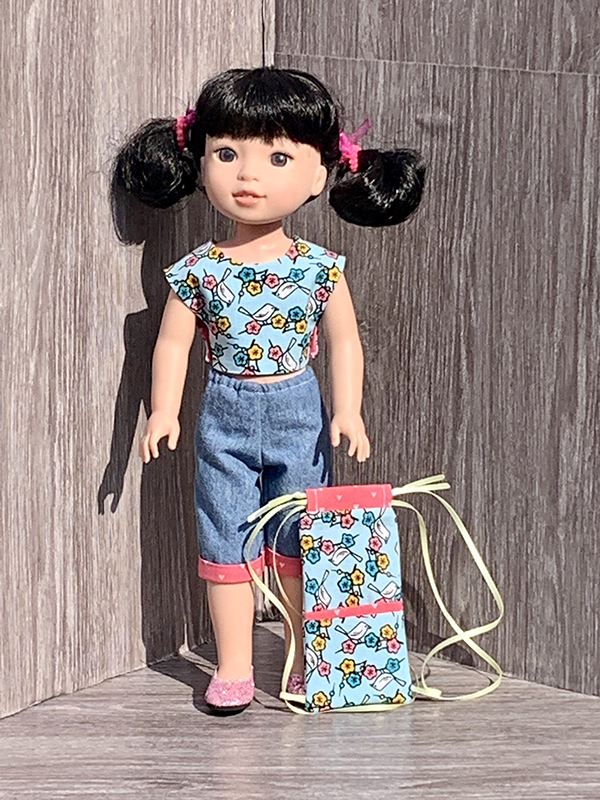 Download and sew the quick and easy Picnic Play PDF sewing pattern and make a summer outfit for your American Girl Wellie wishers Doll. Also fits Ruby Red Fashion Friends. Find more doll clothes sewing patterns in the OhSewKat Etsy shop.