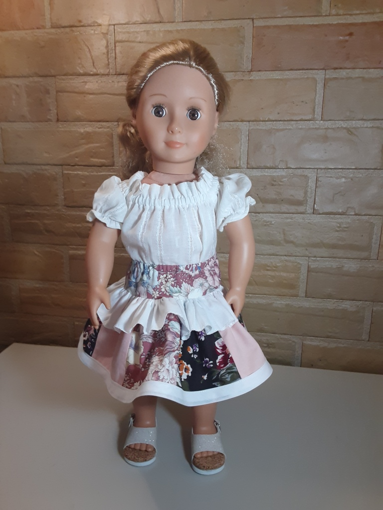 18 inch doll with white top and ruffled, layered skirt from Oh Sew Kat! Twinkle Twirl Sewing Pattern